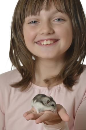 little girl with little hamster