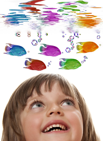 freshwater aquarium fish: little girl looking at colored fish Stock Photo