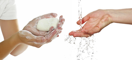 hands and soap on white background Stock Photo