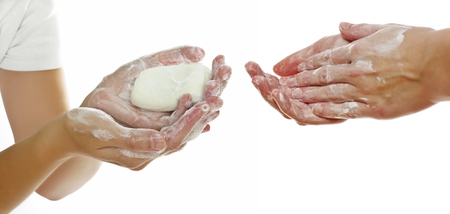 anti bacterial soap: hands and soap on white background Stock Photo