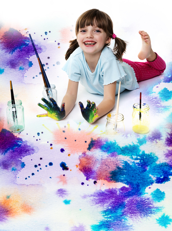happy little girl playing with colors on white background