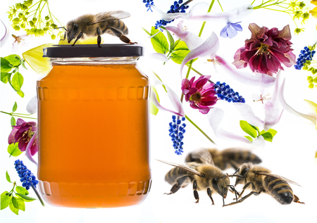 a jar glass with honey isolated on white background