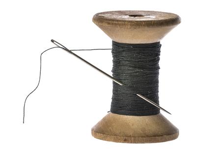 黒糸と銀針の目でリール 写真素材