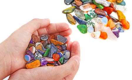hand with collection of semiprecious natural stones