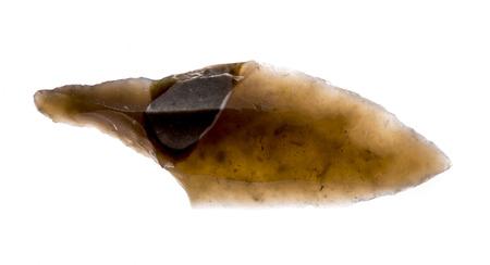 an arrowhead made from flintstone close up - experimental archeology Reklamní fotografie