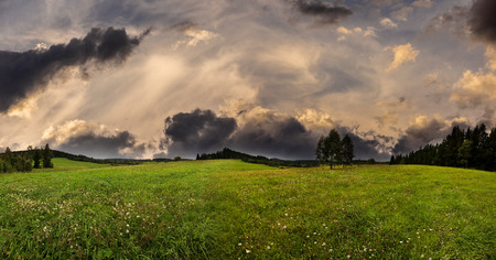 green fresh spring meadow and sunset sky  - panoramic picture Reklamní fotografie