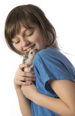 a happy litle girl with African pygmy hedgehog