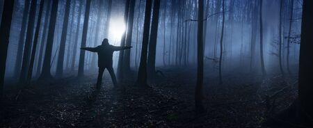 one alone man in a dark foggy forest Banco de Imagens