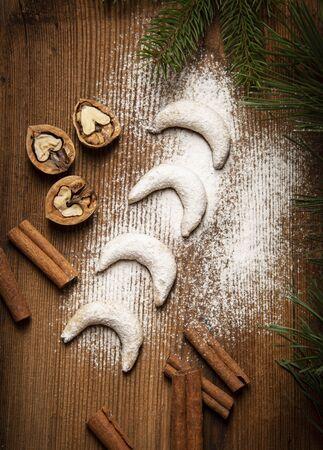 sweet christmas cookies Vanillekipferl on old wooden table 写真素材