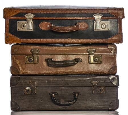 Old brown suitcases on a white background