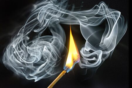 a match with fire and smoke