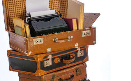 Old brown suitcases with old retro typing machine