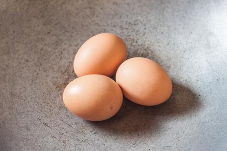 steel pan: eggs on Steel pan Foto de archivo