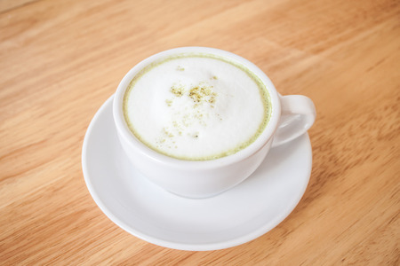 green drink powder: green tea latte on wood table
