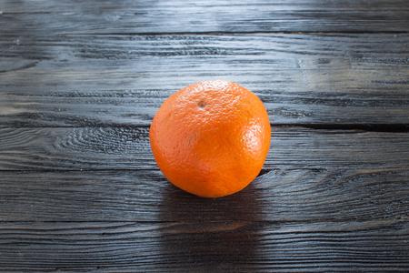 sweet segments: Orange  Wood background
