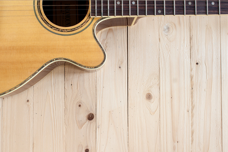 bluegrass: guitar acoustic on top wood table Stock Photo