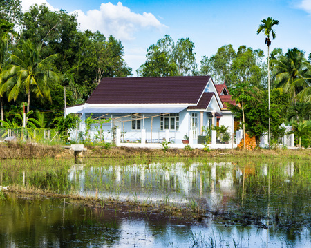 lake dwelling: Vietnamese village. a lone house stands on the shore of the lake Stock Photo