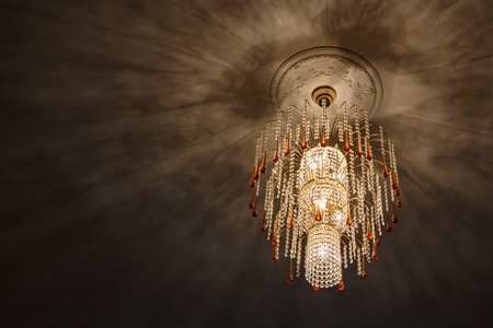 selective focus of Crystal Chandelier , Chandelier ceiling lights, black shadows on the ceiling of the chandelier