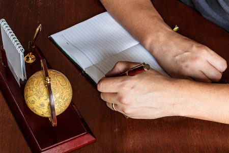 entries: man writes with his left hand in the diary entries. left-handed