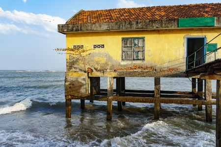 house on stilts in the open sea.
