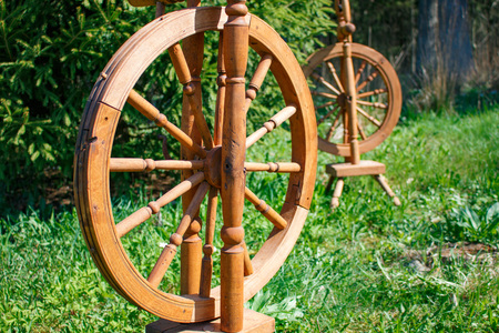 spokes: Old wooden spinning swirling amid the green park.