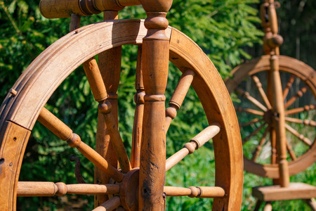 Old wooden spinning swirling amid the green park.