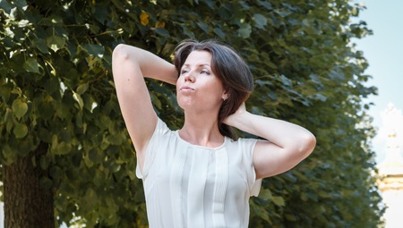 fashion of nice pretty young hipster woman walks in the park in a blouse. portrait. emotions Stock Photo