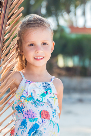 little beautiful girl posing on the beach.