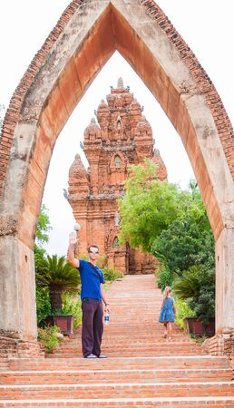 the man and little girl stand on the enter of Poklongarai champa tower. Located in Phan Rang, to the south of Nha Trang Stock Photo