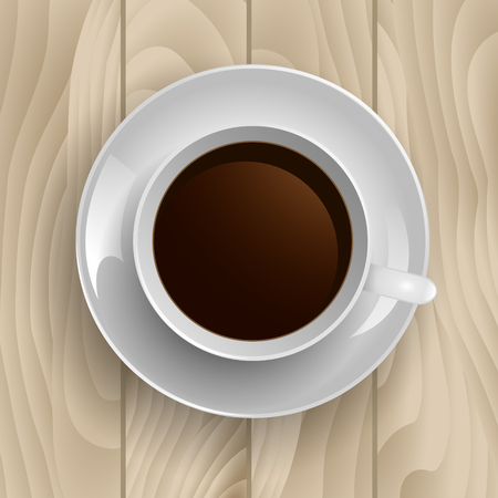 Cup of coffee on  a wooden background. Top view.