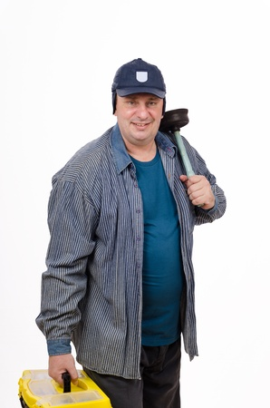 Matured plumber with yellow box and plunger photo