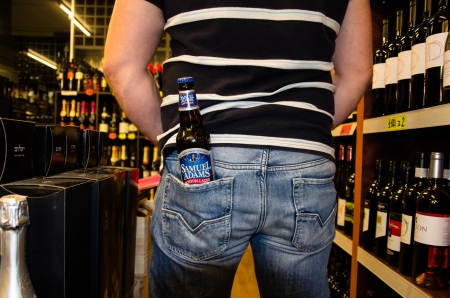samuel: One Bottle Samuel Adams in mans pocket