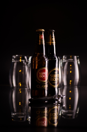 Two bottles of Super Bock beer with glasses
