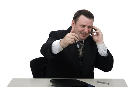 Cheerful middle-aged businessman talking on the phone photo