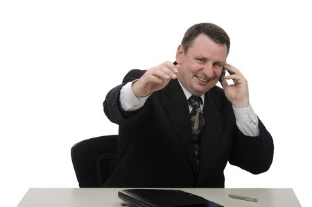 Happy middle-aged man with mobile phone in the office photo