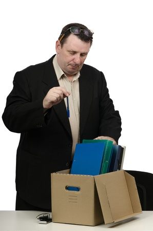 downsize: Fired man carrying his belongings into office box