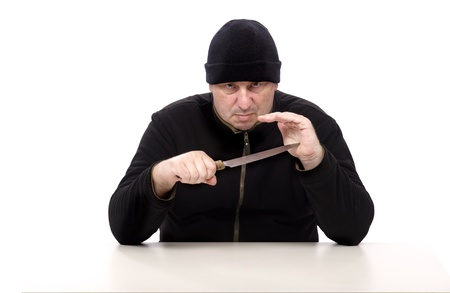 Murderer in black clothes with kitchen knife photo