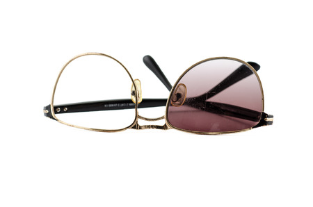 mangy: Mangy broken plastic sunglasses on white