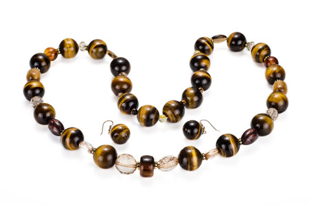 Tiger eye necklace with earrings on white backgroud photo