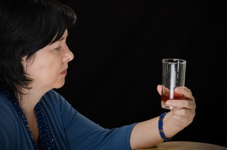 potation: Alcoholic woman with glass of brandy