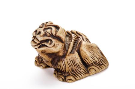 lion figurines: Karashishi Fo netsuke on the left side