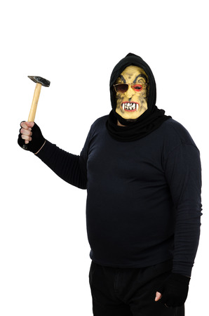 bonkers: Maniac in a mask brandishes a hammer Stock Photo