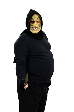 atrocity: Maniac in a mask threatens with a knife