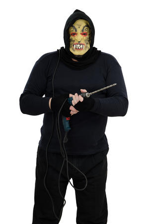 bonkers: Maniac in a mask holds a electric drill