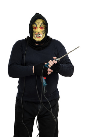 bonkers: Maniac in a mask threatens with electric drill