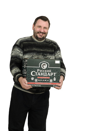 quencher: Bearded man has bought a box of Russian Standard vodka Editorial