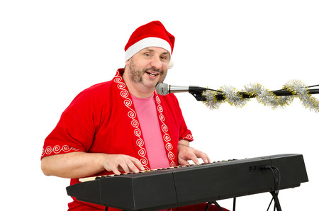 Man in Santa Claus suit singing a song Stock Photo - 24480795