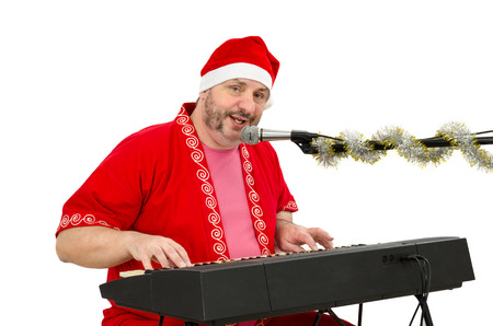 Man wearing Santa suit plays and sings on electric piano Stock Photo - 24480796
