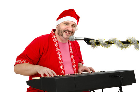 Man in Santa Claus suit having fun with electric piano Stock Photo - 24480797