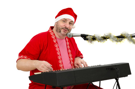 Santa plays and sings on electric piano Stock Photo - 24480798